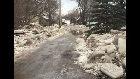 Flooding Leaves Mounds of Ice on Neighborhood Streets in Vermilion