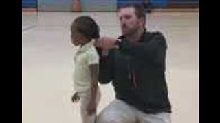 Coach Helps Fix Student's Hair During Gym Class