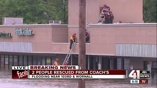 Crews rescue 2 people trapped inside a south KC restaurant due to flooding - Video