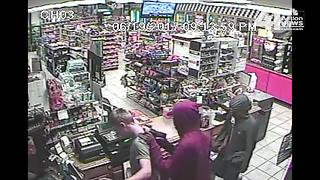 Officials ask for help to identify two armed robbery suspects - Video