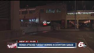Man with a large knife attacks, robs woman at downtown parking garage - Video