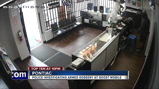 Video shows armed robbery at Pontiac cell phone store - Video