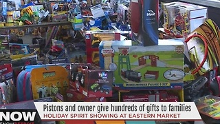 Pistons owner gives gifts to families - Video