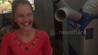 Prankster dad tricks daughter into thinking air conditioner unit is a video game - Video