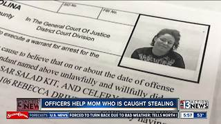 Police officers help mom caught stealing - Video