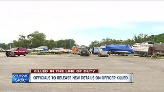 Officials to release new details on officer killed during traffic stop - Video