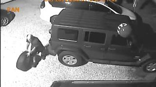 Surveillance video: Wheel stolen off back of Jeep