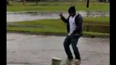 Man Makes Most Of Flooding By Taking To Street For Usher Parody