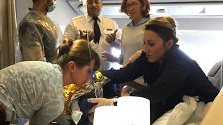 Doctor Delivers Baby Boy in First Class on Flight From Paris to New York - Video