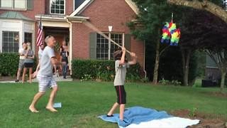 Young Boy Breaks A Piñata And Runs Away With It - Video