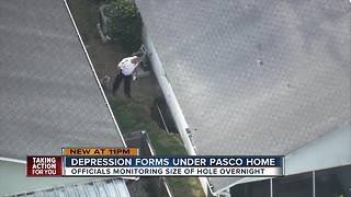 Large depression threatens homes in New Port Richey - Video