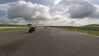Motorcyclist crashes after being knocked out by flying debris - Video