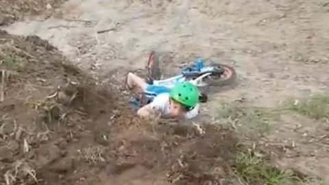 Young Dirt Biker Loses Balance And Face Plants On The Ground