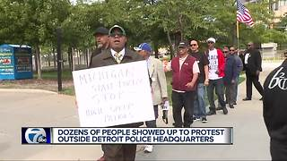 Dozens of people protest outside Detroit police headquarters - Video