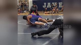 Wrestling referee makes CRAZY slide across mat - Video