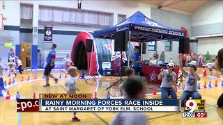 Rainy morning forces race inside - Video
