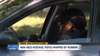 Man held hostage, pistol-whipped by robbers - Video