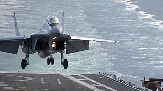 Slow Motion Footage Of Jet Fighter Landing Onto Aircraft Carrier