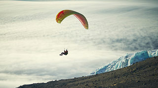 Breathtaking footage of daredevil paraglider flying above clouds from Kilimanjaro - Video