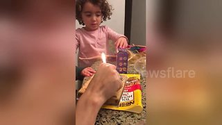 Boy struggles to blow out birthday cake candle