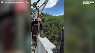 Gentle shove prompts hesitant woman to make bungee jump