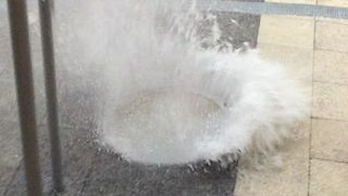 Water Sprays From Manholes After Heavy Rainfall in Downtown Miami - Video