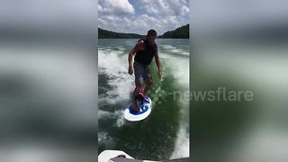 Surf's up! Dog enjoys riding on surfboard with owner