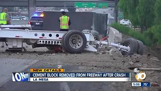 Cement block removed from freeway after crash