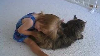 Little girl bonds with her elderly cat