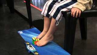 5-Year-Old Boy Solves Rubik's Cube With His Feet - Video