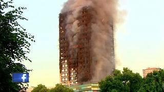 firefighter battle London apartment fire - Video