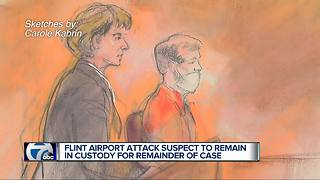 Flint Airport attack suspect to remain in custody for remainder of case - Video