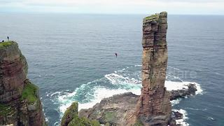 Daredevil performs first high wire walk to sea stack in Scotland - Video