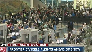 Frontier cancels 23 DIA flights before storm - Video