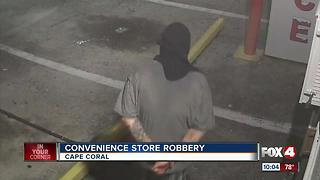 Police search for convenience store robber - Video