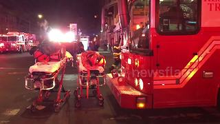 Emergency services at scene of Bronx fire - Video