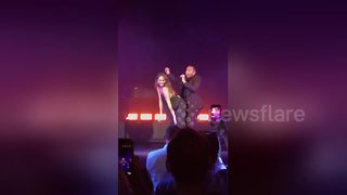 Chrissy Teigen suffers 'wardrobe malfunction' during John Legend concert - Video