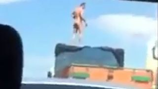 Man standing on a lorry in highway - Video