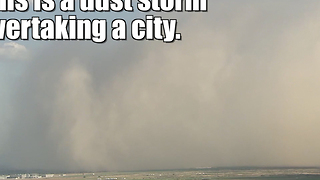 Dust storm overtakes a city - Video