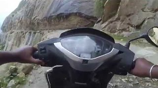 Man Rides Small Motorbike on the 'World's Most Dangerous Road' - Video