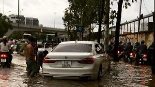 Motorists Negotiate Flooded Streets of Ho Chi Minh City - Video