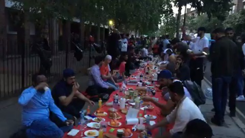 Muslim Community Holds Iftar Meal on the Street Following Grenfell Tower Fire