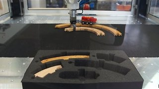 Robot Impressively Controls Makeshift Toy Train Track - Video