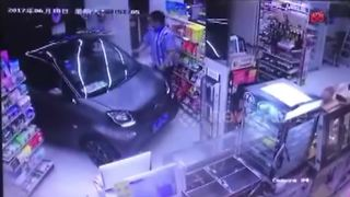 Man drives Smart Car into shop on raining day - Video