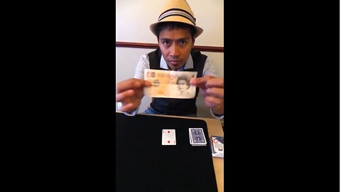 Magician makes playing card penetrate £10 bill