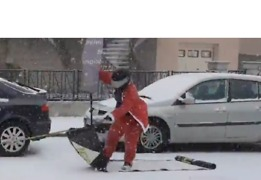 Slippery Santa Sleds Along Snowy French Street - Video