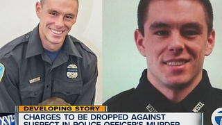 Charges may be dropped against suspect in police officer's murder - Video