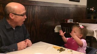 """A Man Talks to A Tot Girl in A Restaurant"""