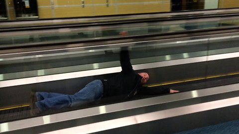 Guy has a funny way to kill time at the airport