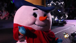 Seasonal cheer dances down Main Street in Disneyland's holiday parade